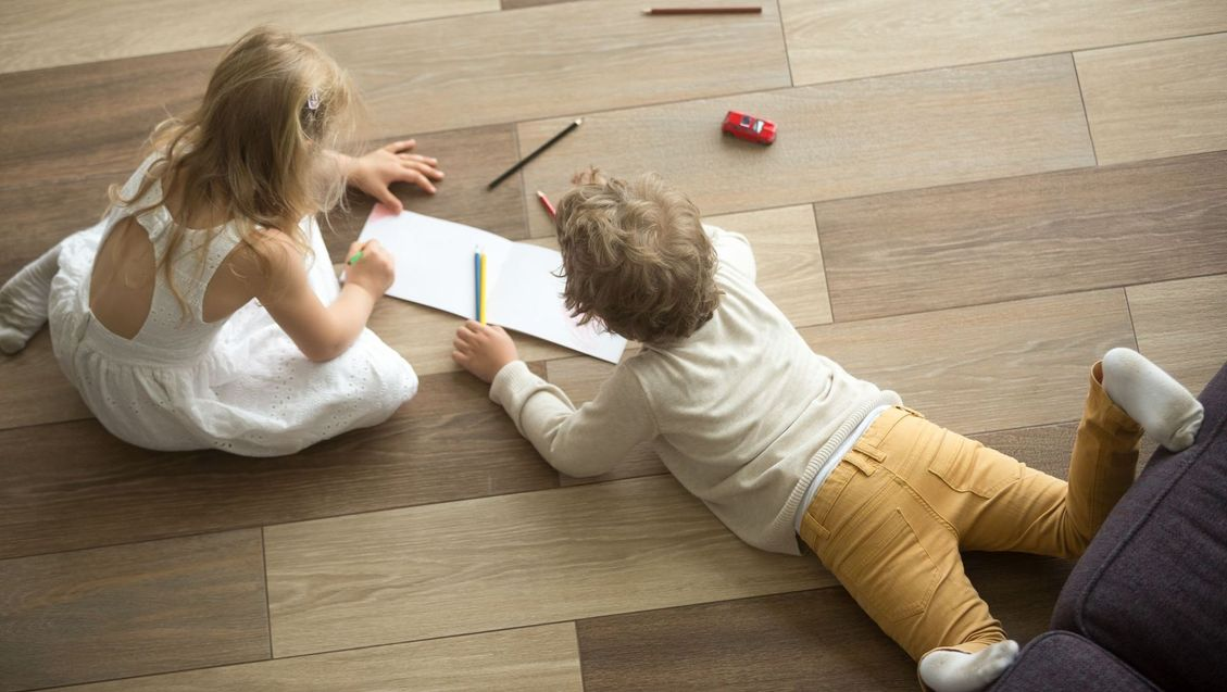 children playing on hard wood flooring